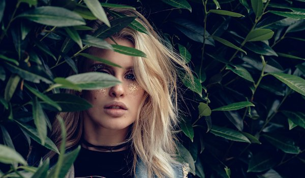 Blonde in the leaves of a flower | Portrait Photography | Anya Kay Photography